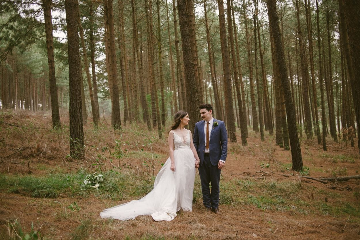bride and groom romantically looking at each other outdoors